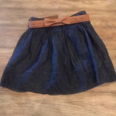 Denim skirt Denim skirt, hits right above knee, tan bow belt included, never worn Vida Skirts