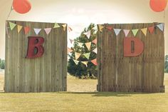 Vintage barn doors and metal letters make this alter one of a kind.   Barn doors & letters by Roadside Vintage Rentals.
