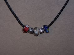 European Glass Bead and Charm necklace by DLSLimited on Etsy
