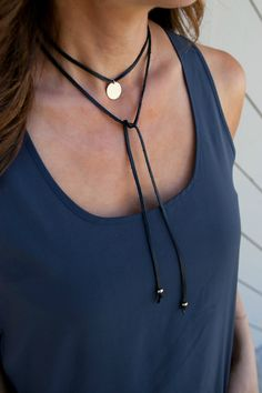 The Leather Wrap Choker/Lariat Tie is a fun and versatile necklace! Wear as choker or lariat tie. Choose either a sterling silver or 14K gold filled 5/8 hammered or blank disc to compliment the black or brown genuine leather wrap. *CHOOSE between a hammered or blank disc ...........and....... BLACK or BROWN leather  - premium 16mm (5/8)14k Gold Filled or Sterling Silver - signature hammered finish on the disc - 47 genuine leather wrap with gold or silver bead at each end - each...