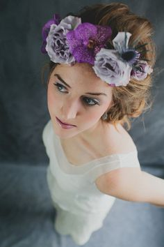 Hair crown by Sullivan Owen. Vanda orchid, spray roses, thistle
