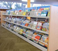3 shelf high face out display shelving for children's collection.