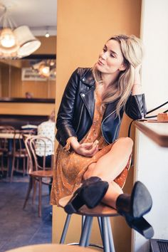Leather jacket with a sweet dress. My kind of pretty!