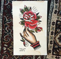 Art by spencer Evans. Traditional hand holding a rose tattoo.
