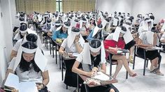Bizarre Anti-Cheating Paper Hats Spark Controversy in Thailand - http://www.weirdlife.com/bizarre-anti-cheating-paper-hats-spark-controversy-in-thailand/