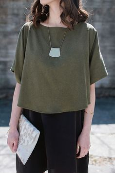 Minimal trends | Structured khaki top, black skirt, clutch and a necklace