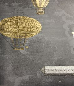 Macchine Volanti  Wallpaper Wonderous flying machines in silver and gold, sitting amongst the stormy grey clouds.  This wall art comes as a set of two rolls.