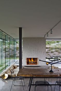 Glass walls, table and fireplace