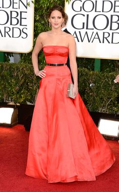 Jennifer Lawrence stuns in a red Christian Dior Haute Couture strapless gown cinched with a gold waistband at the 2013 Golden Globes.  http://www.eonline.com/photos/6427/the-best-of-the-red-carpet/249057