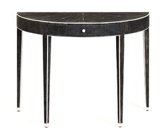 """Classical but luxurious,"" says Jamie Drake of this shagreen-covered table. ""The bone trim shows off the demilune like a line drawing."" He sees the 39.5""-wide table in a chic urban space with black glass vases.  $7,800; johnlyledesign.com.   - ELLEDecor.com"