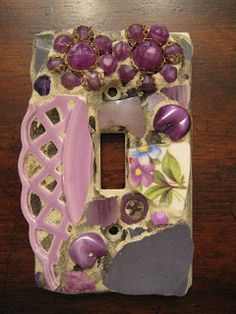 Mosaic single switch plate with vintage earrings and lavender lattice plate.