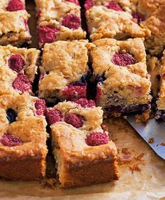 This delicious traybake is wonderfully moist and celebrates apple and blueberry, with delicious, vibrant pops of raspberry - a comforting teatime bake.