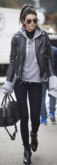 Grey sweatshirt + black moto jacket + black skinnies + aviators + studded booties + oversized bag