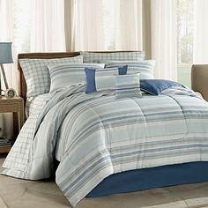 Cora is complete bed ensemble featuring a casual, distressed printed horizontal stripe in earth tones and blue, reversing to a denim blue.