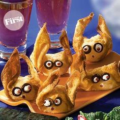 Wacky Wonton Bat Bites-1 pkg. (16 oz.) egg-roll wrappers, like Nasoya 1 pkg. (8 oz.) cream cheese with chives and onions 1 qt. corn oil 5 pitted olives, sliced 2 Tbs. pink peppercorns