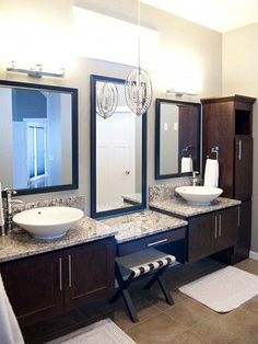 Love this bathroom vanity/sink combo. Would change out the mirrors and handles on the cabinet.