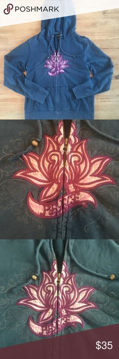 "Lucky Brand embroidered boho zip up hoodie Lucky Brand embroidered floral boho zip up hoodie.   Navy blue with adorable embroidered floral design.   Length is approx 24"" and chest is approx 18"" across laying flat zipped.   Great condition. Lucky Brand Tops"