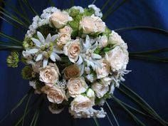 Eryn's edelweiss bouquet...white roses with navy ribbon