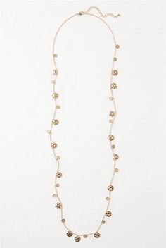I wear this long strand necklace with everything!     $38