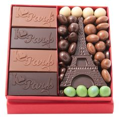 Gift box filled with chocolate dragees, tablets custom Welcome or I Love Paris Eiffel Tower and a chocolate milk or black.