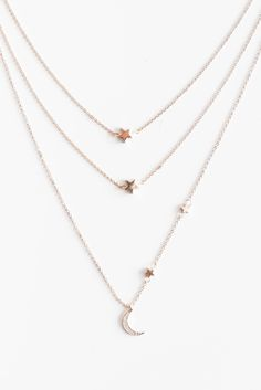 """Layered star necklace with a dangling cubic zirconia encrusted moon pendant. Total length measures approx 16"""" with a 3"""" extender. Lobster clasp closure."""