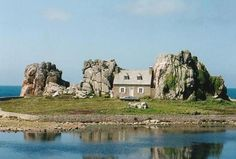 "This is the famous ""house between the rocks"" located in France, along La Côte de Granit Rose in Brittany near Plougrescant."