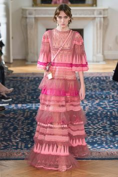Picturesque silhouettes and oh-so pretty hues of pink in the Valentino Spring Summer '17 collection.