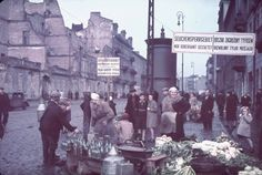 """Haunting color photographs made by Adolf Hitler's personal photographer, Hugo Jaeger, in the ghettos of Warsaw and the smaller Polish city of Kutno in Nazi-occupied Poland in 1939 and signs read, """"Typhus area. Passage permitted only while traveling. Jewish Ghetto, Warsaw Ghetto, Warsaw Poland, Invasion Of Poland, Life Pictures, World War Two, Budapest, Wwii, Images"""