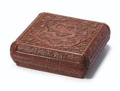 A CARVED CINNABAR LACQUER BOX AND COVER MARK AND PERIOD OF WANLI, DATED IN ACCORDANCE WITH 1595