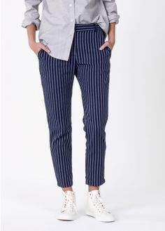 Pair this cropped suit trouser with a fitted or oversized blazer for versatile menswear style.