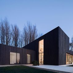 Strips of dark-stained timber give a charred appearance to the three stacked blocks that form this house in the Netherlands which replaces another property that was destroyed by fire. Photograph is by Marc Goodwin. We've got plenty more examples of black-stained houses on http://ift.tt/1VMzK80 #architecture #house #Netherlands by dezeen
