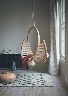 Positioning this stunning hanging chair in a minimalist corner shows it off in all its crafted glory.