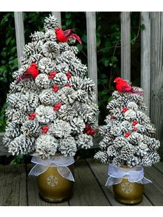 This rustic towering topiary adds understated drama to your winter décor. #pinecones #diy #crafts