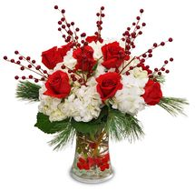Snowcapped Roses. Flower arrangements, holiday plants, centerpieces, and gift baskets from Ray Hunter Florist, Garden and Christmas Shop. We deliver anywhere! Visit the our Christmas Wonderland Store for high-quality holiday decor, trims, and floral offerings in Southgate, Michigan at 16153 Eureka or call 734-285-2400. #christmasflowers #christmasgifts