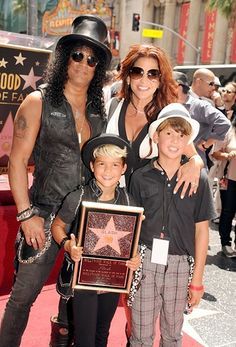 Slash and Perla Ferrar pose with their children Cash Hudson and London Hudson at the Hollywood Walk of Fame on July 10, 2012.