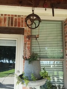 Old pulley and chicken feeder=planter. Thanks to my wife Pat.