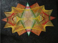 trabajo hecho con hilos de colores y clavos sobre tablero de madera de 30x25x1mm. añadido pintado de negro al óleo. lema: Galaxia