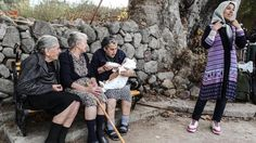 Post with 628 views. A photographer caught three Greek grannies singing to the little boy of a Syrian refugee that just washed ashore in order to calm him down and get him to eat