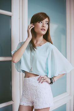 Flutter Sleeve Crop Top (1044) Size S -PTP 15-16 in, length 15 in  Size M - PTP 16-17 in, length 15 in  Top is meant to be worn loose fit  Measurements indicated above are approximate and actual piece received may differ by +/-0.5 inches  Details Made of chiffon with inner lining  Flutter sleeve - not lined  Crop top Available in Black , White and Mint  Model is UK 6 , Height 166cm with waist size 23.5 in SGD26.50