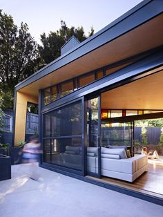 Love the glass doors to the outside but not so much the modern geometric exterior