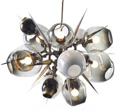 This is such a fabulous chandelier...love the organic hand blown shapes...This belongs over my dining room table. by Lindsey Adelman