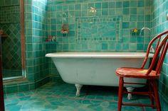 Turquoise and orange make a fun combination in the bathroom [Design: Filmore…
