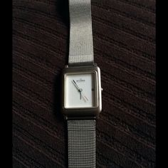 100% authentic Skagen ladies watch This watch is beautiful and simple. It is silver with a metal band and white face. It does need a battery, but it runs perfect! Skagen Jewelry