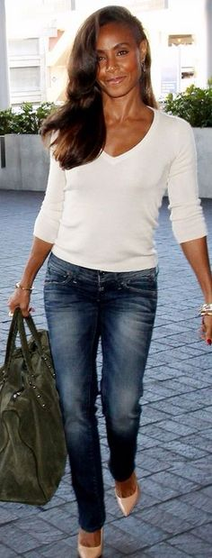 Who made Jada Pinkett Smiths blue jeans and green suede handbag that she wore at LAX airport?