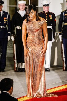 Michelle Obama's State-Dinner Dresses -  At the 2016 last state dinner for Italy wearing Versace.