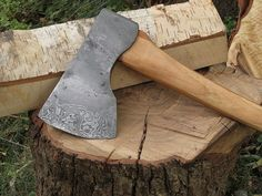 This axe was wrapped and welded with a body of mild steel and an edge of 1095 and 15n20 with a central core of 1084 giving the edge about 32 layers. The head is 8 1/4 inches long and the edge is a little over 6 inches, with the weight of the whole axe sitting at about 4 pounds. The handle is hickory and measures 35 1/2 inches long. . By Robert G. Burns