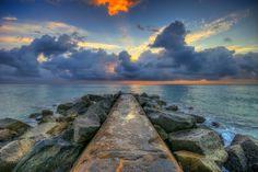 Palm Beach Inlet Stormy Sunrise at the Jetty.   Photo courtesy of Kim Seng | CaptainKimo.com