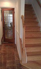 Real hardwood stairs next to hardwood-looking tile.  Great design elements.
