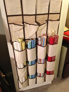 SUCH A GREAT IDEA for efficient, inexpensive wrapping storage! Shoe pockets as organizer for wrapping paper. Seperate Christmas, Birthday, Baby, General, so it is all simple to find. Cut the bottoms off the pockets on the 2nd and 3rd sections.