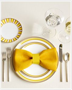 This bow tie napkin fold will add a fun pop to your table decor. Fold your napkin so the two halves meet in the middle. Fold it again, the same way as before, making a long strip. Fold the ends…Read more › Bow Tie Napkins, Linen Napkins, Cloth Napkins, How To Fold Napkins, Place Settings, Table Settings, Led Shop, Napkin Folding
